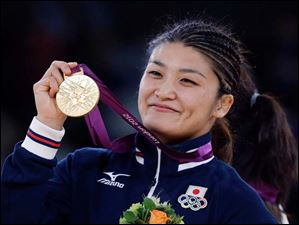 Gold medalist Kaori Icho of Japan, participates in the awards ceremony for 63-kg women's freestyle wrestling.