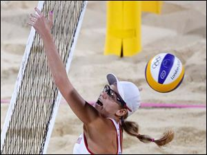 United States' Jennifer Kessy misses the ball during a women's gold medal beach volleyball match against United States' Kerri Walsh Jennings and Misty May-Treanor.