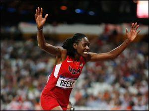 United States' Brittney Reese celebrates winning gold in the women's long jump final.