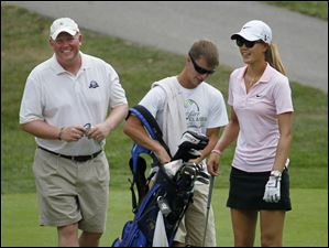 Stephen Taylor, left, plays with golfer Michelle Wie.