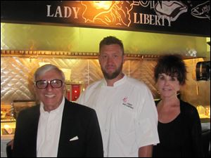 Jamie and Joy Farr with Chef Rob Campbell at Revolution Grille.