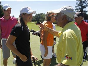 Lourdes University student golfer and Sylvania resident Brooke Darah chats with Jamie Farr.