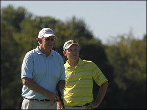Steve Dunbar, left, and Kevin Brennan on the putting green.