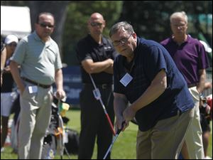 Toledo Clinic's Scott Porterfield putts during the Pro-Am putting tournament at Highland Meadows.