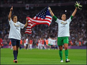 Carli Lloyd, left, and Hope Solo celebrate Team USA's 2-1's victory over Japan to capture an Olympic gold in women's soccer. Lloyd scored both goals for the United States.
