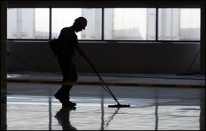 A Jeep worker prepares the floor at Chrysler's new 267,000-square-foot body shop.