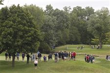 Fans-surround-the-8th-green