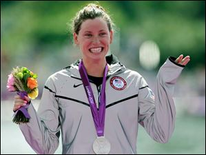 Silver medalist Haley Anderson of the United States reacts during a medals ceremony after  the women's 10-kilometer marathon swimming competition.