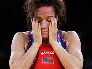 Kelsey Campbell of the United States reacts after losing to Yuliya Ratkevich of Azerbaijan during the 55-kg women's freestyle wrestling competition.