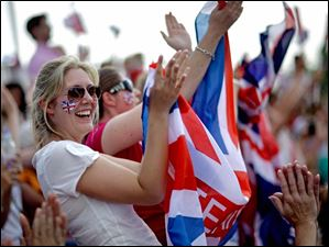 Spectators cheer as Charlotte Dujardin, of Great Britain, completes her routine with her horse Valegro to win the gold medal in the equestrian dressage individual competition.