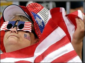 Heidi Miller, of Detroit, cheers for the USA against South Korea during a women's volleyball semifinal match.