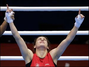 Ireland's Katie Taylor, celebrates winning her fight against Russia's Sofya Ochigava, in a women's lightweight 60-kg gold medal boxing match.
