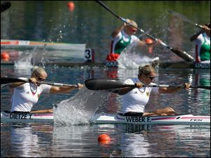 Germany's Frnaziska Weber, right, and Tina Dietze paddle on their way to winning the gold medal  in the women's kayak double 500m,