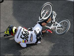 Colombia's Carlos Mario Oquendo Zabala crashes during a BMX cycling men's quarterfinal run.