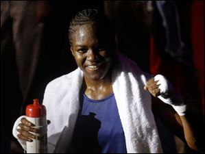 Great Britain's Nicola Adams, celebrates winning her gold medal match against China's Ren Cancan, during women's flyweight 51-kg boxing.