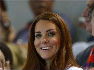 Kate Middleton, Duchess of Cambridge watches the synchronized swimming team technical routine.