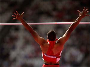 United States' Ashton Eaton competes in the men's decathlon pole vault.