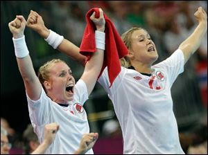 Norway's Karoline Dyhre Breivang, left, and team mate Marit Malm Frafjord react after scored a goal during their women's handball semifinal match.