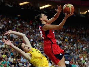 USA's Diana Taurasi, right, charges into Australia's Belinda Snell, left, during a women's semifinals basketball game.