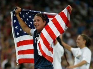 Abby Wambach #14  of the United States celebrates after defeating Japan by a score of 2-1 to win the Women's Soccer gold medal match.