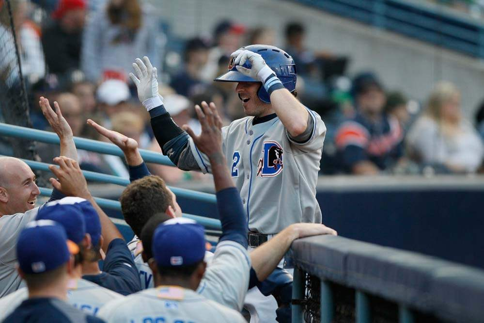 Durham-Bulls-player-Will-Rhymes-is-greeted-by-teammates