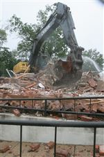 Crews-clean-up-debris-after-demolishing-the-popculture-building