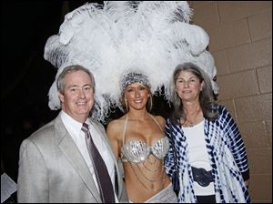 Mike and Carol Anderson pose with Jessica Bovia for a picture during the Hollywood Casino Gala Dinner & Show at the SeaGate Centre in Toledo, Ohio, on Tuesday.
