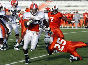 Bowling Green State University running back Jamel Martin (37) runs the ball during a scrimmage Saturday.