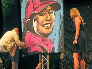 Artist David Garibaldi and Paula Creamer subject of the portrait at the LPGA Gala.