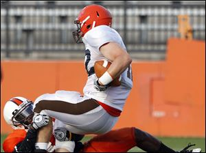 Bowling Green State University (20) tight end Chris Pohlman (42) makes a catch against BGSU defender Jude Adjei-Barimah (14)during a scrimmage Saturday.