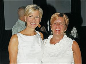 Diane Larson, an evening anchor for 13ABC, poses for a picture with Mary Gerkau, Director of Sales at 13ABC, during the Hollywood Casino Gala Dinner & Show at the SeaGate Centre in Toledo, Ohio, on Tuesday.