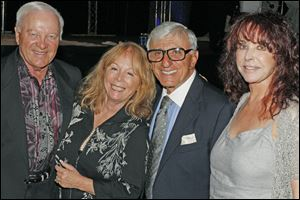 Larry and Sue Resnick pose for a picture with Jamie and Joy Farr during the Hollywood Casino Gala Dinner & Show at the SeaGate Centre in Toledo.