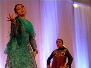 (left to right) Sumiran Shah and Kimi Shah perform an Indian Fusion dance at the Festival of India held at the Hindu Temple of Toledo in Sylvania in August 2011. The festival showcased dance performances as well as food and jewelry and clothing for sale.