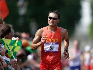 China's Si Tianfeng competes in the men's 50-kilometer race walk.