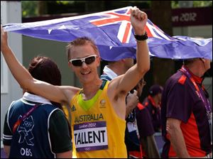 Jared Tallent of Australia celebrates taking the silver medal in the 50-kilometer men's race walk.