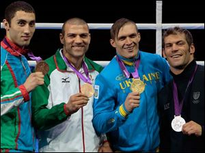 From left, bronze medalist Teymur Mammadov of Azerbaijan, bronze medalist Tervel Pulev of Bulgaria, gold medalist Oleksandr Usyk of Ukraine, and silver medalist Clemente Russo of Italy, participate in the medals ceremony for heavyweight 91-kg boxing.