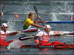 Russia's Yury Postrigay (R) and Alexander Dyachenko push forward to winning the gold medal in the men's kayak double 200-meter final.