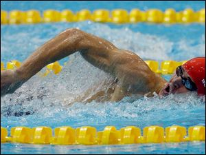 Nicholas Woodbridge from Great Britain competes during the swimming competition as part of the modern pentathlon at the Aquatics Centre in the Olympic Park.