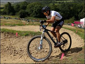 Germany's Sabine Spitz (1) competes in the Mountain Bike Cycling women's race. Spitz won the silver medal in the race.