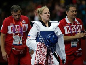 Russia's Anastasia's Baryshinkova walks off the mat after fighting Tunisia's Khaoula Ben Hamza in women's plus 67-kg taekwondo competition.