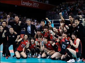 Japan poses for a photo after the team defeated South Korea during a women's volleyball bronze medal match at the 2012 Summer Olympics Saturday.
