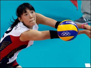 South Korea's Han Song-yi passes during a women's bronze medal volleyball match against Japan.