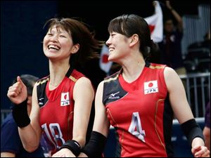Japan's Saori Kimura, rear, hugs Mai Yamaguchi following a three set win over South Korea during the women's volleyball bronze medal match.