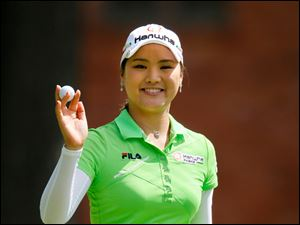 So Yeon Ryu beams after sinking a birdie putt on No. 12. She shot a 20-under-par 264 to win the tournament.