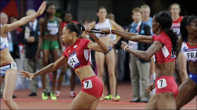 American DeeDee Trotter, second American DeeDee Trotter, second from right, hands the baton to Allyson Felix during the 4x400-meter relay Saturday in London. The United States won by a whopping 3.36 seconds over Russia.