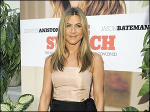 "Jennifer Aniston, a cast member in ""The Switch,"" poses at the premiere of the film in Los Angeles."