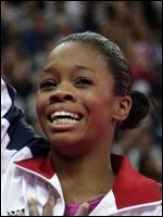 U.S. gymnast Gabrielle Douglas acknowledges the audience after being declared winner of the gold medal during the artistic gymnastics women's individual all-around competition at the 2012 Summer Olympics.