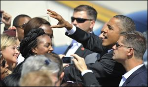 President Barack Obama greets a crowd of people Saturday after arriving at O'Hare International Airport in Chicago.