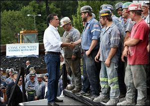 Republican presidential candidate and former Massachusetts Governor Mitt Romney greets coal miners during a campaign rally at American Energy Corportation in Beallsville, Ohio. Mitt Romney is wrapping up his multi state bus tour with campaign events in Ohio.