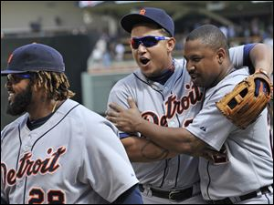 Detroit Tigers' Miguel Cabrera, center, and Delmond Young, right, celebrate the Tigers' 5-1 win over the Minnesota Twins  in a baseball game Wednesday.